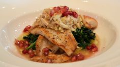 Seared Flounder with almond-crab butter, pomegranate vinaigrette, polenta, wilted greens and pomegranate seeds | Green Valley Grill | Greensboro, NC