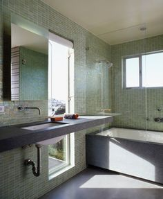 If you are fortunate to have a generous tile budget, pick out a tile in your favorite hue and clad the entire wall. Its the perfect wall covering for a wet environment.
