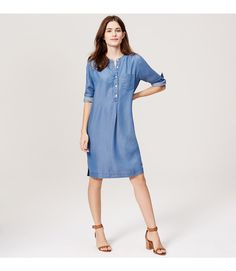 """Keep it cool and comfy in this super soft shirtdress, a polished silhouette freshed up by modern chambray and a slouchy fit. Round neck. Long sleeves with button cuffs. Henley button placket. Patch chest pocket. Shirred beneath back yoke. Split sides. 20"""" from natural waist."""