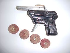 cap gun with rolls of caps. we'd use our fingernails to ignite the caps and sometimes we smash a whole roll with a hammer for a big explosion!