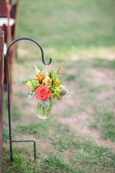 Example of aisle flowers hung from shepherds hooks.