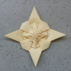 with two more added layers, 30 cm square off leather paper  original star by Tomoko Fuse, diagram published in her book Quilts... thanks to Melisande and Andrew Hudson and >Andrea Acosta I could fold it and play with fractalization (what Andrew did here)