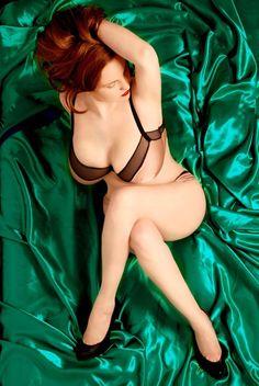 Sexy busty redhead.