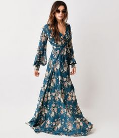 It's a floor length fantasy! A breathtaking seventies inspired maxi dress boasting a deep surplice v-neckline, cuffed lo...Price - $98.00-ukVgdF9G