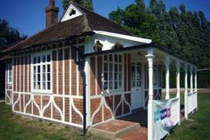 The Tabernacle, The Mote Cricket Club, Maidstone. Built as a private cricket and entertainment pavilion, the small, single-storeyed cricket pavilion with a verandah facing the cricket pitch, was designed in the Vernacular Revival style and is a rare example of a pre-1914 cricket pavilion, restored to its original condition between 2011 and 2013.