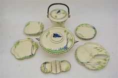A collection of Art Deco 'Bluebell' pattern Burleighware ceramics including a biscuit barrel and