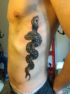 Rod of Asclepius done by Alex Videogame at DeadPixelTattoos in Craiova, RO R Tattoo, Snake Tattoo, Body Art Tattoos, New Tattoos, Cool Tattoos, Tatoos, Nurse Tattoos, Awesome Tattoos, Caduceus Tattoo