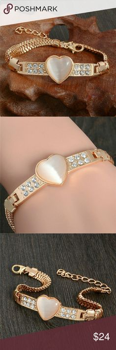 NEW 18KGP BRACELET New 18 KGP bracelet. Opal heart shape stone in center with  CZ stones on either side 4 Bidden Boutique Jewelry Bracelets