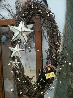 Planning on this type of wreath to hang above the front gate using a round of rusted barbed wire as a base.