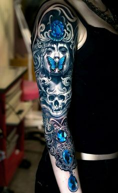 I love this whole tattoo but the bottom is what Im looking at for my coverup. love the design and the colors