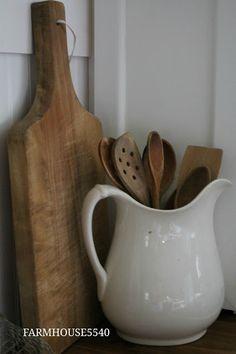 store kitchen accessories in a white pitcher.