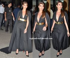 Ileana attended the Filmfare Awards wearing separates from Nikhil Thampi Label that not only featured his signature wide metallic belt but also included a dramatic cape.  The outfit that showed plenty of décolleté was finished out with Dior earrings, a sleek ponytail and black pumps. She looked fabulous!  - See more at: http://www.highheelconfidential.com/tag/filmfare-awards-2015/page/7/#sthash.182CGsXw.dpuf