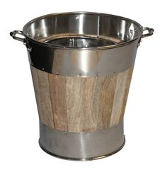 Lined wooden coal bucket with a stainless steel trim. This coal bucket is available in two sizes, please select from the drop down which size you require, they can also be purchased in a set of two including one bucket of each size.Keep your coal or wood stored in a tidy way using this stylish coal bucket with two handles for easy carrying.
