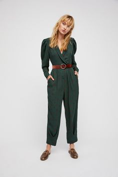 Star Eyes Jumpsuit | Effortless printed jumpsuit featuring a plunging neckline and statement shoulders with pleat detailing. * Hidden button and exposed button closures at the waist * Straight legs * Pleat detailing at the waist * Hip waist * Zip fly