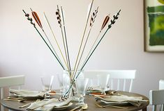 Group a piece of these handmade decorative arrows in a glass vessel for an unexpected centerpiece at your next dinner party!