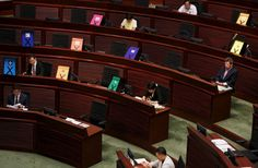Signs symbolizing veto to a Beijing-backed electoral reform are displayed by pro-democracy lawmakers during a Legislative Council meeting in Hong Kong, June 17, 2015. More than a thousand people converged on Hong Kong's Legislative Council early on Wednesday before lawmakers debate a Beijing-backed electoral reform plan that could trigger fresh protests in the Chinese-controlled city. REUTERS/Bobby Yip