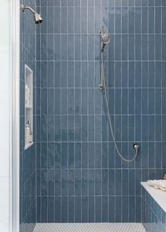 I just love the glossy look of these shower tiles from Ann Sacks, laid in the vertical pattern. The jumbo penny tile floor is a nice contrast in shape, size and color for this shower stall.  Bathroom Remodel - Carla Aston, Designer | Photographer, Colleen Scott Guest Bathrooms, Vintage Bathrooms, Penny Tile Floors, Blue Subway Tile, Marble Look Tile, Master Bedroom Redo, Quartz Slab, Kitchen And Bath Remodeling, White Bathroom