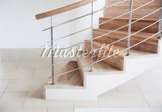 Wooden staircase and railing in modern house Stock Photos