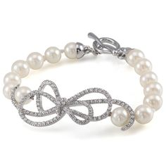 The Christine White Pearl and Crystal Bow Bracelet $50.00 (This is one of my personal favorites!) Available at: Allyson James Bridal