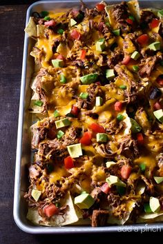Brisket Nachos make a quick and easy way to repurpose leftover brisket. So simple and so delicious, it will become a favorite! // addapinch.com