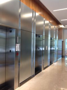 Elevator Lobby using SEFAR Vision Glass panels.  AL 140/70
