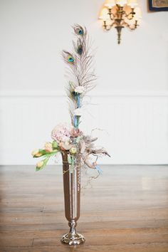 Tall centerpiece with peacock feather   Laura Power Photography   see more on: http://burnettsboards.com/2014/07/eclectic-wedding-historic-manor-house/