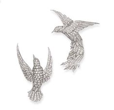 A PAIR OF DIAMOND SWALLOW BROOCHES, BY TIFFANY & CO.   Each designed as a pavé-set diamond bird in flight, mounted in platinum  Signed Tiffany & Co.