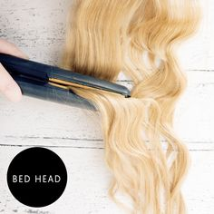 Get a gorgeous bed hair curl with your straighteners by moving them over and under