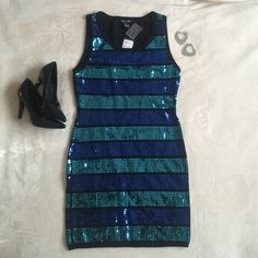 Forever 21 Black Teal & Blue Sequin Mini Dress Forever 21 Black Teal & Blue Sequin Mini Dress. Size L. Brand new with tags and little bag of extra sequins. Black dress with real and royal blue sequins. It has a fitted/tapered style to it so it's not very stretchy. Would look amazing for a holiday party or new year's get together  No trades but offers are welcome  Forever 21 Dresses Mini