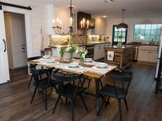 The second story of the Meek home has been completely transformed. Walls were removed to open the space and a new kitchen and dining room were added to allow for more hosting, as seen on Fixer Upper. (after)