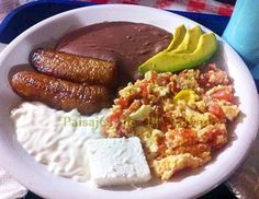 Autentico desayuno Salvadoreño...sooo good! Creama, plantains,refried small red beans, avocado and scrambled eggs with salsa.
