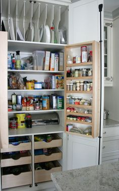 Love this storage pantry idea.   Top shelves great for lids and baking sheets and look at those extra shelves that open to reveal pantry