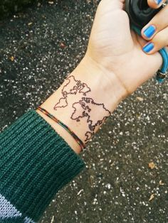 she loves adventure - so much so she'll get an awesome map tattoo on her wrist!