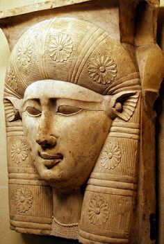The face of the goddess Hathor, with cow ears. A fragment of a capital from a column. 3rd century BC, Ptolemaic. located in Louvre Museum.