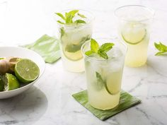 Used these proportions for Mojitos...except used 1/2 light rum, 1/2 dark rum, muddled leaves in lime juice and used less than half the sugar. Then filled tall glass with ice and filled with diet sierra mist. So, ok, totally changed it.