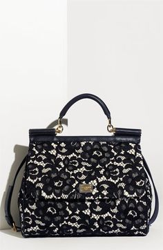 """Being prim and proper need not be boring with this gorgeous Dolce & Gabbana """"Miss Siciliy Lace"""" Satchel."""