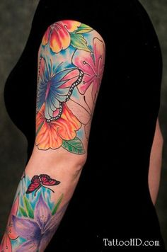 floral pastel tattoos for arm | Colored Flowers And Butterfly Tattoo On Arm