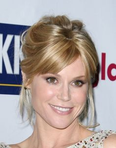 Julie Bowen wears a casual updo hairstyle