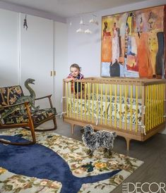 A child's bedroom in a WestVillage apartment wiht a crib by Kalon Studios and a whale rug from Anthropologie.