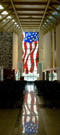 This stained glass window is in the foyer of the Dole Institute of Politics located in Lawrence Kansas and is part of the University of Kansas depicts Senator Dole's hometown of Russell Kansas.