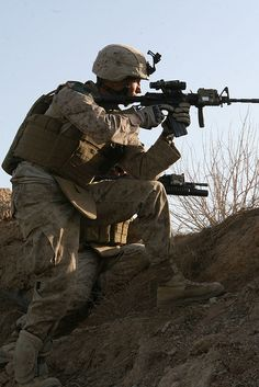 Marines fire from berm by United States Marine Corps Official Page, via Flickr