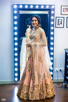 Sangeet Lehengas - Baby Pink Lehenga with White Dupatta | WedMeGood | Baby Pink Satin Lehenga with Bronze Embroidered Motifs and White Net Dupatta Outfit by : Mrinalini Rao #wedmegood #indianbride #indianwedding #lehengas #babypink #bronze #netdupatta