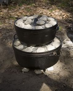 Cooking a multi course meal with stacked dutch ovens and BBQ briquettes. Firewood works the same way, build up a base of coals and scoop them onto the dutch oven lids. You want heat applied to both top and bottom-these containers become ovens. Bake bread, biscuits, corn bread or pie in top  oven while main course is simmering below. Cook in a stack of three, making stew, bread and pie. Start the stew well before baked items.