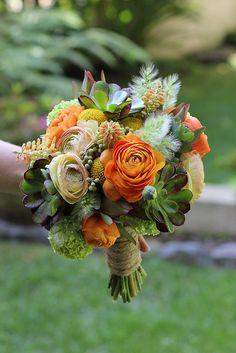 Bridal bouquet of succulents, orange ranunculus