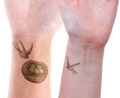 bird and nest tattoo