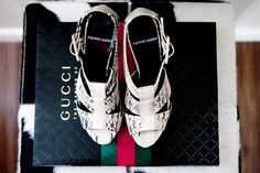 Pierre Hardy python sandals, Gucci book, cowhide stool