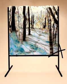 Glass depiction of a winter day in the woods.  Beautiful