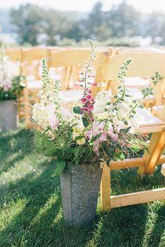 Fill aluminum pails with foxgloves, stock, leather fern, lemon leaf, and ornamental grasses | Brides.com
