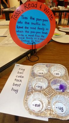 Literacy station ideas.  toss the pom-pom into the muffin tin.  Read the word family on which the pom-pom lands. Write a word from the word family on a paper. Continue as time allows. Could work for older kids using prefixes and suffixes - maybe on dice?  Could be used with musical notes to create measures of music.