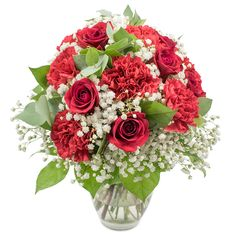 Let this delightful bouquet warm the hearts of your loved ones and deliver your best seasonal wishes! Featuring red roses and carnations, this arrangement speaks of festivity, luxury and joy. Christmas Flowers, Winter Flowers, Amazing Flowers, Colorful Flowers, Early May Bank Holiday, Red Carnation, Hand Tied Bouquet, Same Day Flower Delivery, Mothers Day Flowers